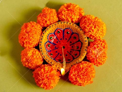 Diwali lamp and flower rangoli